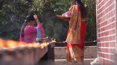Two ladies light a candle,Tansen,Nepal Stock Footage