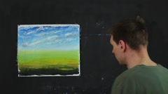Artist working on painting. Process of creating paintings on canvas. Stock Footage