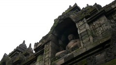 Tilt down from a buddha statue at the Borobudur a 9th-century Mahayana Stock Footage