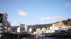 4K Time Lapse of Blue Sky over Atami Station in Japan -Zoom Out- Stock Footage