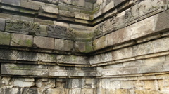Tilt up to a buddha statue at the Borobudur a 9th-century Mahayana Stock Footage