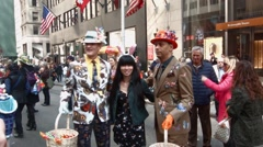 Stock Video Footage of NEW YORK - APRIL 5:  Two people pose with their Easter attire during The 2015 Ea