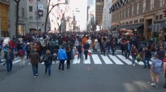 Stock Video Footage of NEW YORK - APRIL 5:  Crowds of people gather on 5th Ave. to take pictures of peo