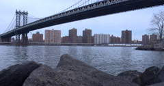 4K - Dumbo Beach. View of the East River Under the Manhattan Bridge Stock Footage