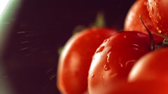 Drops of water on tomato rotates Stock Footage