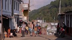A motorcycle passes in a street,Tansen,Nepal Stock Footage