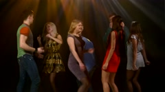 Group of friends talking while dancing to the music. Action takes place in a Stock Footage
