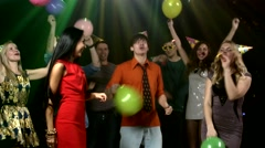 Friends dancing the nightclub fray streamers and they throw balls Stock Footage
