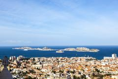 aerial view of one of the Frioul islands and the town of Marseilles - stock photo