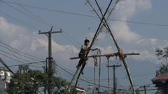 Man repairing giant swing,Pokhara,Nepal Stock Footage