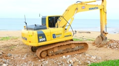 Excavator moves to the excavation site Stock Footage