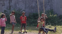 Kids playing on the giant swing,Pokhara,Nepal Stock Footage