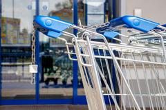 Shopping cart in front of a supermarket Stock Photos
