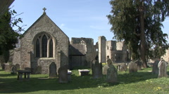 Church and ruined abbey at Easby, North Yorkshire. Stock Footage