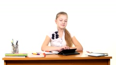 School girl taught lessons using the tablet computer doing homework on white Stock Footage