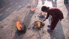 Kids poking fire in Swayambhunath,Kathmandu,Nepal Stock Footage
