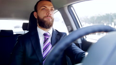 Serious business man listening music in car dancing Stock Footage