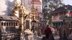 Pelgrims circle Swayambhunath temple,Kathmandu,Nepal Stock Footage