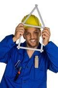 Handyman with helmet Stock Photos