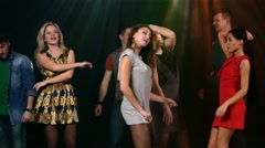 Large group on the dance floor in club. Girl dancing foreground - stock footage