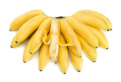 Bunch of bananas with open one - stock photo