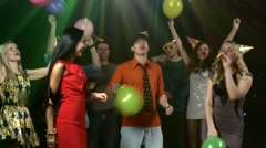 Friends dancing the nightclub fray streamers and they throw balls - stock footage