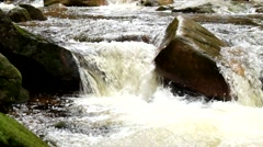 Big boulders. Slipper stones and chilly water around. Noise of huge of water. - stock footage