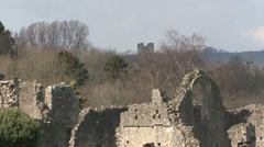 Ruins of Easby Abbey with Richmond Castle in distance. Stock Footage