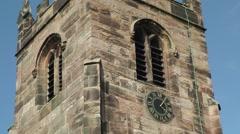 Church rural countryside tower gargoyle clock blue sky.mp4 Stock Footage