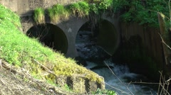 Country stream culvert rushing flowing rural countryside Stock Footage