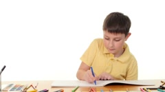 Cheerful little boy with felt-pen drawing on white background Stock Footage