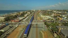 Oceanside Aerial, train moving Stock Footage