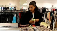 Young Attractive Black Woman Shopping for Purse/Hand bag Stock Footage