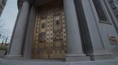 Downtown old bank door Stock Footage