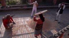 People winnowing grain,Dhulikehl,Nepal Stock Footage