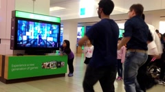 Microsoft xbox demonstrates dance game - stock footage