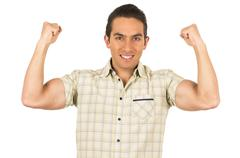 young handsome hispanic man posing showing arm muscles - stock photo