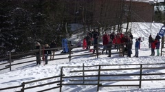 4k People waiting at winter fun toboggan cable lift Harz - stock footage