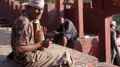 Folk singer in Gorkha Durbar,Gorkha,Nepal Stock Footage