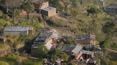 View on farm houses with kids on Giant swing,Gorkha,Nepal Stock Footage