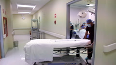 FULL SHOT-HANDHELD SHOT. Nursing staff and surgeons in a hospital corridor. Stock Footage