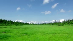 Grassland and sky in Hachimantai, Iwate Prefecture, Japan Stock Footage