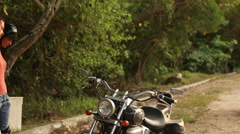 Girl in helmet and  equipment comes to motorbike Stock Footage