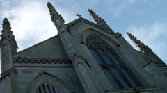 Church exterior with stained glass, spire, cathedral Stock Footage