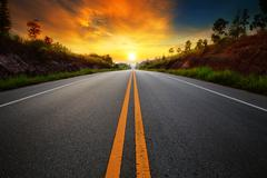 Beautiful sun rising sky with asphalt highways road in rural scene use land t Kuvituskuvat