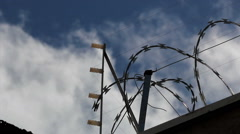 Time lapse. Clouds and security fence. Razor Wire Fencing and Barbed Wire. Stock Footage