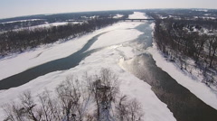 Aerial descend towards icy river Stock Footage