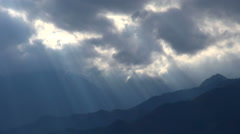 Sunlight filtering through clouds on mountainscape, Nagano Prefecture, Japan Stock Footage