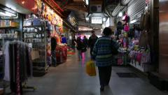 Old lady walking in the dark shopping area (street) Stock Footage