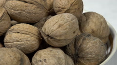 Not Shelled Walnuts in a Bowl - stock footage